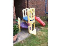 Children's play frame with slide