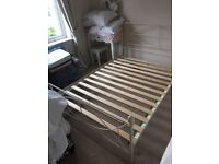 White wrought iron double bed
