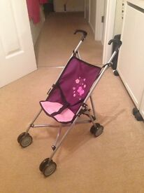 Children's dolls pushchair in pink and purple. Perfect condition. Smoke free home.