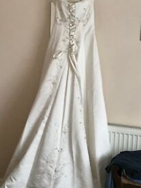 Ivory wedding dress. Romantica. Size 10.