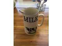 Heron cross pottery milk jug