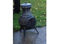 Grey coloured outdoor wood burning Chimnea