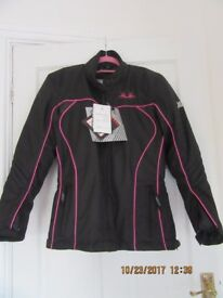 Ladies Tracy biker jacket, Black and pink, never used still has original label attached.