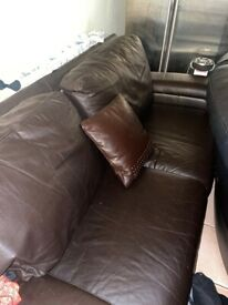 Brown faux leather settee in excellent condition £50 ono as needs to go asap.