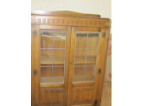 Early 20th century wooden glasses cabinet