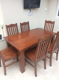 Veneered table and six chairs