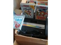 Atari 7800 game consol and 5 games for sale.with manual and original box
