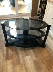 Black glass TV and media stand in perfect condition.
