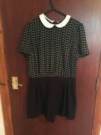 Black print playsuit size 12