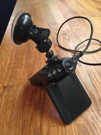 Dash board video camera with windscreen fixer
