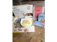 Medela swing breast pump, storage bags, nipple cream