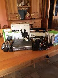 Sold-Xbox360 with kinect, 11games and charging station