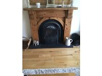 Chunky pine fireplace with inset
