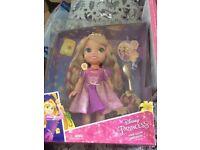 Rapunzel doll hair glow and sings