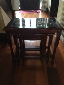 Nest of 3 small dark wood coffee tables