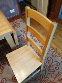 Solid dining table & 6 chairs with fold down side leaf.