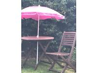 Wooden garden table, two chairs and parasol