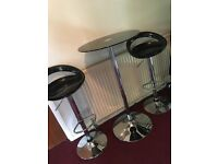 Black and silver bar table and 2 bar stools