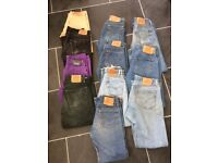 Levis 501 jeans. Used assortment of men and women's jeans in dark/light blue, black, purple.