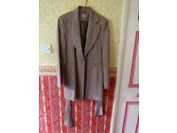 Elegant Beige suit harldy worn