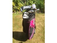 Golf clubs - set of Wilson women's clubs - Right Handed - with bag and trolley