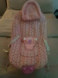 Pink baby bouncer with vibration and music settings