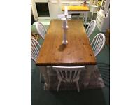 Large farmhouse dining table with six chairs