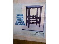 Free standing solid wood wine rack with glass holder. Merlot colour and BOXED