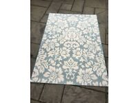 Duck egg blue and cream patterned rug, 120cm x 170cm
