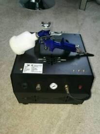 Spray tan compressor machine with gun.