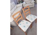 2 upholstered wood frame chairs
