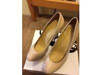 Ladies nude, patent high heel Nine West shoes size UK8