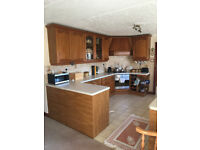 Solid Oak Kitchen units, including gas hob, electric oven and two base unit carousel cupboards.