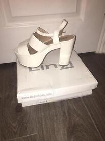 Linzi white heels