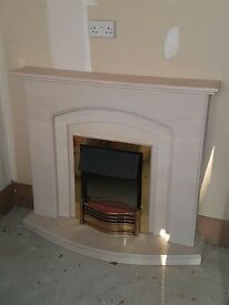 Limestone fire surround and electric fire
