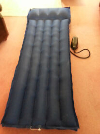 Single airbed and pump, 6' 2'' long.