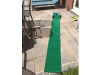 Brand Fusion golf putting mat with ball return