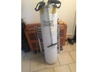 Punching bag with brackets and gloves