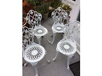 4 beautifully ornate painted white metal garden chairs
