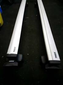 Thule Roof rack and 3 Thurle bike racks