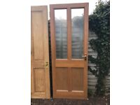 "Internal door - 4 panel door with 2 glass panes. 30"" x 78"" unused."