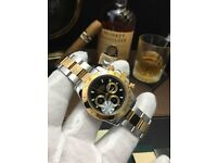 Rolex Daytona With TwoTone Bracelet and Black Face Comes Rokex Bagged and Boxed With Paperwork