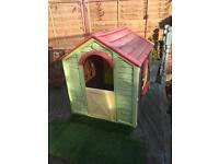Plastic children's garden playhouse