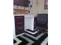 white desk and leather chair