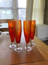 4 orange unique glasses