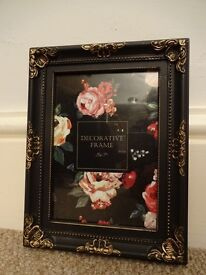 """Photo frame 5"""" x 7"""" or 13 x 18 cm. Black with beautiful gold decoration"""