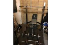 Weight bench squat rack and 124 Kg of various plates