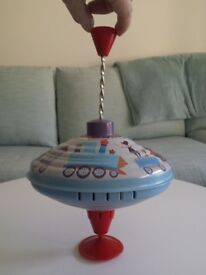 One large sturdy metal retro-inspired spinning top by Moulin Roty. £5.00. Kennington SE11 5NG London