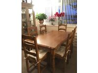 Solid wood dining room table + 6 chairs