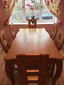 Solid oak table with six solid oak chairs